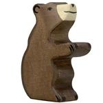Bild von Bruine beer welp zittend Holztiger